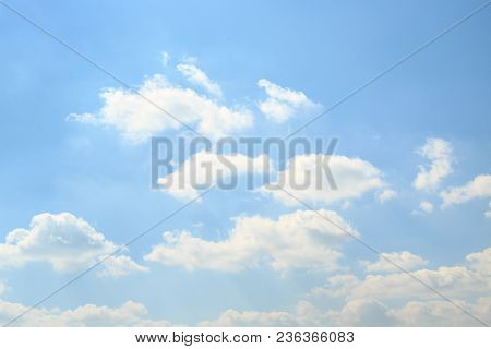 Сalm Light Blue Sky With Fluffy White Clouds In A Bright Spring Day. Ether Background.