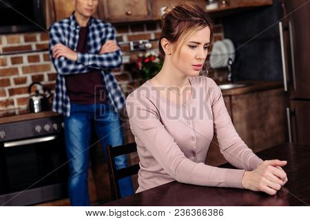 Selective Focus Of Argued Couple In Kitchen At Home, Relationship Difficulties Concept