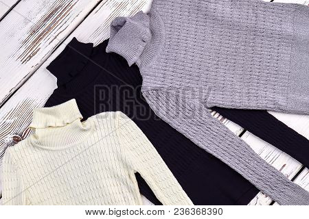 Turtlreneck Knitted Sweaters Setting. Texture Design Warm Turtleneck Sweaters, Top View. Boys And Gi
