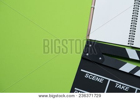 Movie Clapper On Green Background ; Film, Cinema And Video Photography Concept
