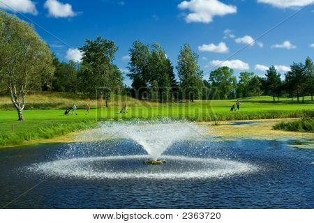 Golf Course With A Pond And A Fontain