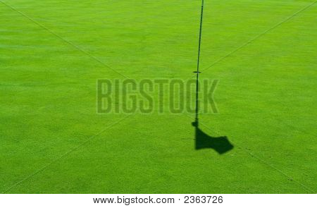 Golf Green And A Flag Shadow