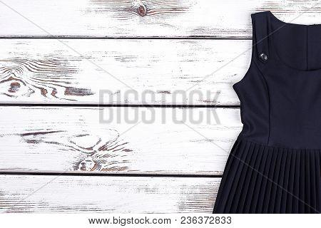 Girls School Dress Uniform, Copy Space. Black Sleeveless Pleated Girls Dress For School Wear. Little