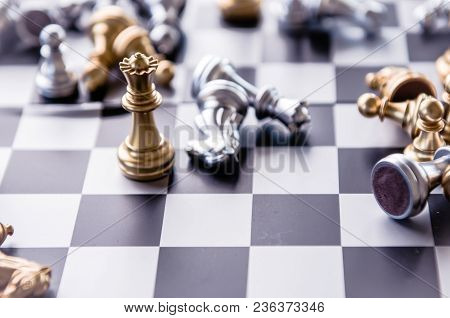 Silver And Gold Knight On Chess Board. Chess Knights Head To Head.business Concept Opponent In Busin