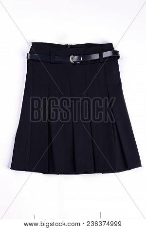 Pleated Black Uniform Skirt Isolated. Girls Beautiful Belted Black Skirt On White Background. Classi