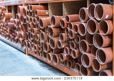 Sewer Pipes In The Building Store. Kg Sewer Pipes. Stacks Of Pvc And Ceramic Water Pipes.