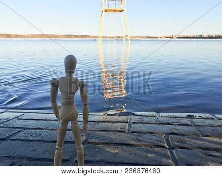 Wooden Doll In The Shape Of A Man On A Background Of Nature 1