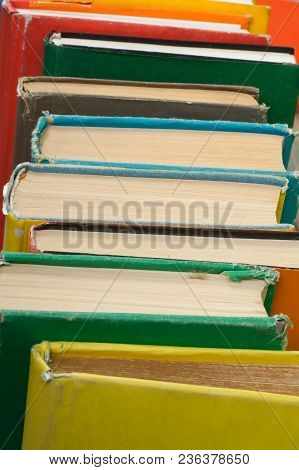 Book Stacking. Open Hardback Books On Wooden Table And Blue Background. Back To School. Copy Space F
