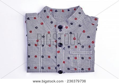 Little Boys New Folded Dotted Shirt. Close Up Of Cute Grey Cotton Shirt For Toddler Boy, White Backg