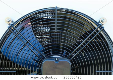 Air Conditioning Machines Equipment Concept. Closeup Of Black Fan On White Machine
