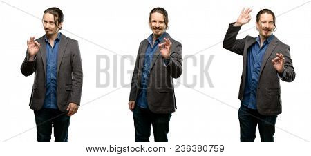 Handsome young man doing ok sign with hand, approve gesture
