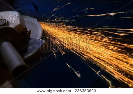 Sparks From Metal Polishing By The Grinder
