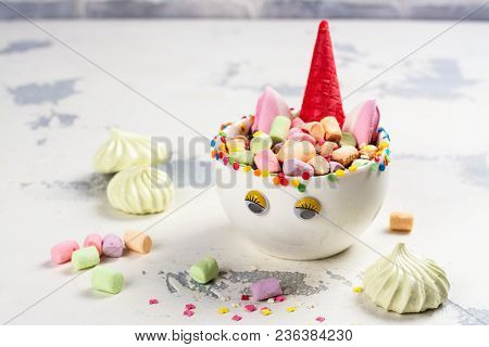 Hot Unicorn Cocoa Or Chocolate In A Porcelain Cup With Funny Eyes. Kids Food Or Drink Concept. Copy