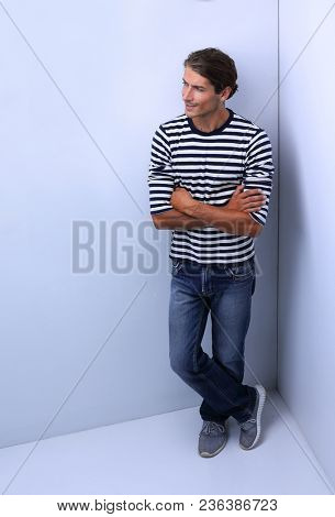 thoughtful man standing in the corner