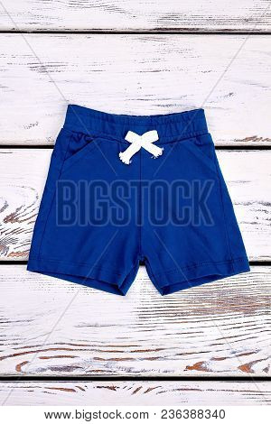 Baby Boy Casual Summer Shorts. Toddler Boy Natural Cotton Shorts On Vintage Wooden Background, Top V