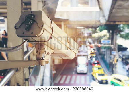 Close Up Of Traffic Security Camera Surveillance (cctv) On The Road To Monitor The Car Traffic Jam A