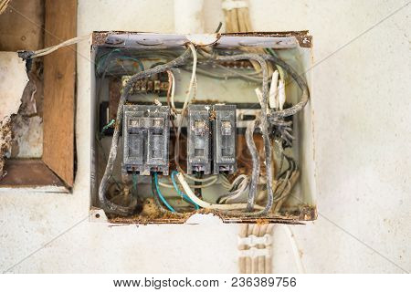 Old And Rusty Electric Circuit Breaker Placed On A Wall In A Rusty Metal Box