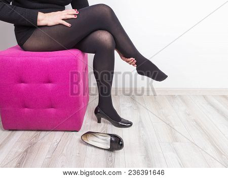 Cropped Image Of Woman In High Heels Massaging Her Tired Legs. Varicose Veins Concept. Painful Spide