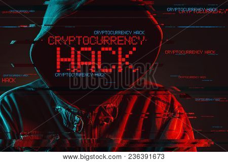 Cryptocurrency Hack Concept With Faceless Hooded Male Person, Low Key Red And Blue Lit Image And Dig