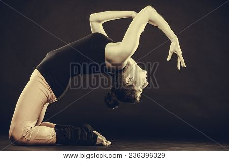 Healthy And Sporty Lifestyle. Fit Slim Girl Doing Stretching. Young Woman Exercising Before Sport Tr