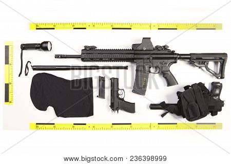 Police Photo Evidence Of Seized Automatic Gun And Other Weapons And Contraband