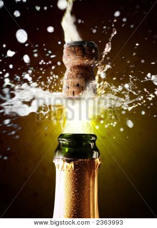 Close up photo of champagne cork popping poster