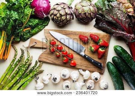 Food Background With Italian Spring And Summer Vegetables And Fruits. Top Shot With Cutting Board An