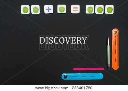 Concept School, Black Art Table With Stationery Supplies With Text Discovery On Blackboard