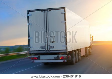 Big Truck Moves On Highway At Sunrise