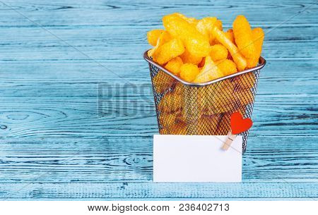 Golden Crispy Chips In An Iron Basket. Copy Space.