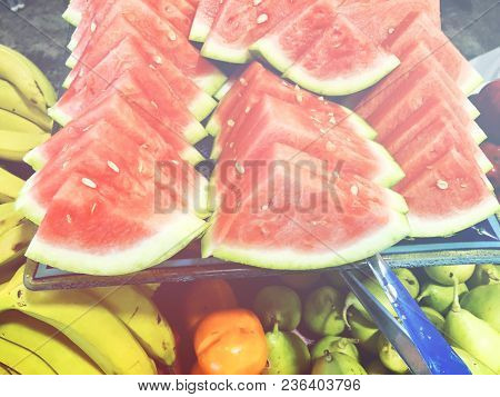 Sliced Slices Of Watermelon Lie Next To Different Fruits. Watermelon In A Cut