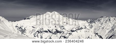 Black And White Panoramic View On Snowy Mount Elbrus And Off-piste Slope. View From Mt. Cheget. Cauc
