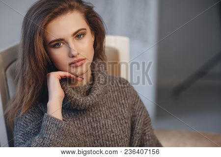 Beautiful Sexy Girl In An Elegant Gray Sweater. Close-up, Portrait Of A Beautiful Woman, Model, Indo