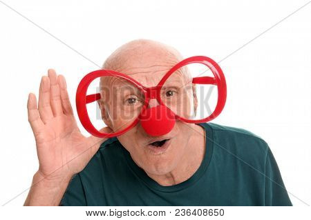 Mature man in funny disguise on white background. April fool's day celebration