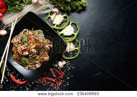 Oriental Cuisine Food. Salad And Vegetable On Dark Background. Wholesome Healthy Eating. Copyspace C