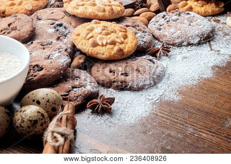 Chocolate Chips Cookies And Peanut Cookies On Dark Rustic Texture With Copy Space For Your Text. Clo