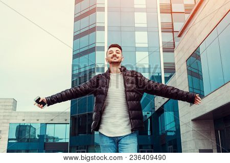 Exams Passed. Happy Arabian Student Outside. Successful And Confident Young Man Raised Hands. Celebr