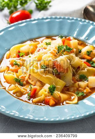 Minestrone Traditional Italian Soup From Vegetables, Tomato And Pasta. Meatless Dish. Close Up. Vert