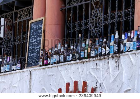 Santo Domingo, Dominican Republic- October 30, 2015: Old Glass Bottles Used As Decoration Outside Lo
