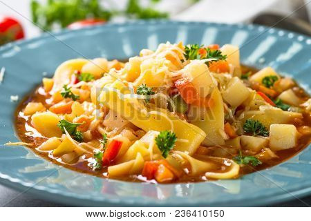 Minestrone Traditional Italian Soup From Vegetables, Tomato And Pasta. Meatless Dish. Close Up.