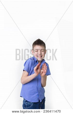 Portrait Of A Young Boy Making Stop Or Reject Gesture Isolated On White Background. Smiling Teenager