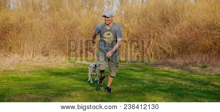 The Man Trains The Dog. Educating Dog. Play With A Pet. Dog Handler.