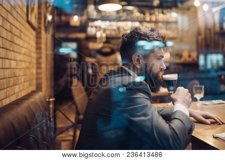 Bearded Man Rest In Restaurant With Beer Glass. Businessman With Long Beard Drink In Cigar Club. Bee