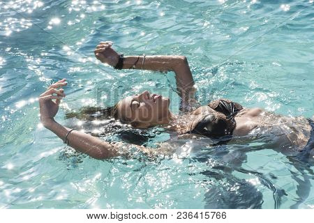 Sexy Woman On Caribbean Sea In Bahamas. Relax In Spa Swimming Pool, Refreshment And Skincare. Maldiv