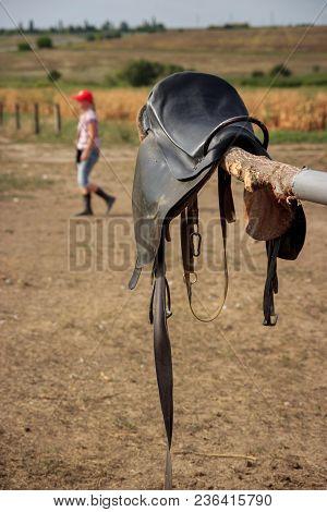 Horse Saddle On Rural Fence. Horse Saddle Close Up