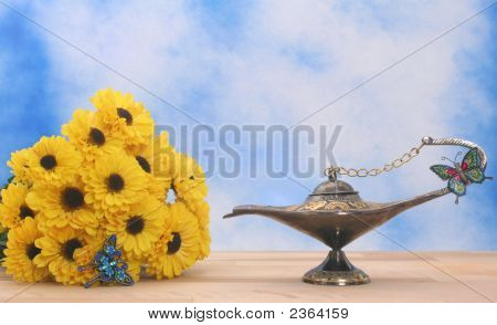 Antique Oil Lamp and Yellow Flowers on Blue and White Textured Background poster