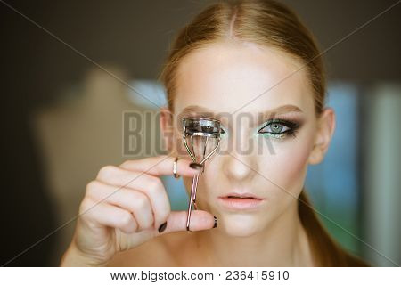 Woman Curl Lashes With Beauty Tool, Look. Woman Use Eyelash Curler For Eye Makeup. Model With Curly