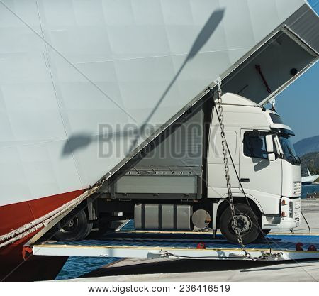 Camion Rides Out Of Ferry, Ferryboat On Sunny Day. Intercontinental Transport. ?argo Van, Truck, Kam