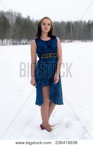 Elegant Young Fashion Woman In Snow Frost Winter Forest