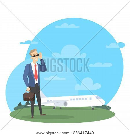 Businessman With Private Jet Standing Near The Plane With Briefcase.